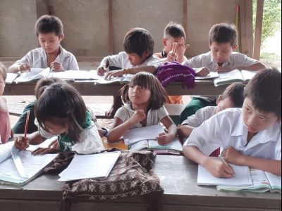 Children studying in temporary classroom